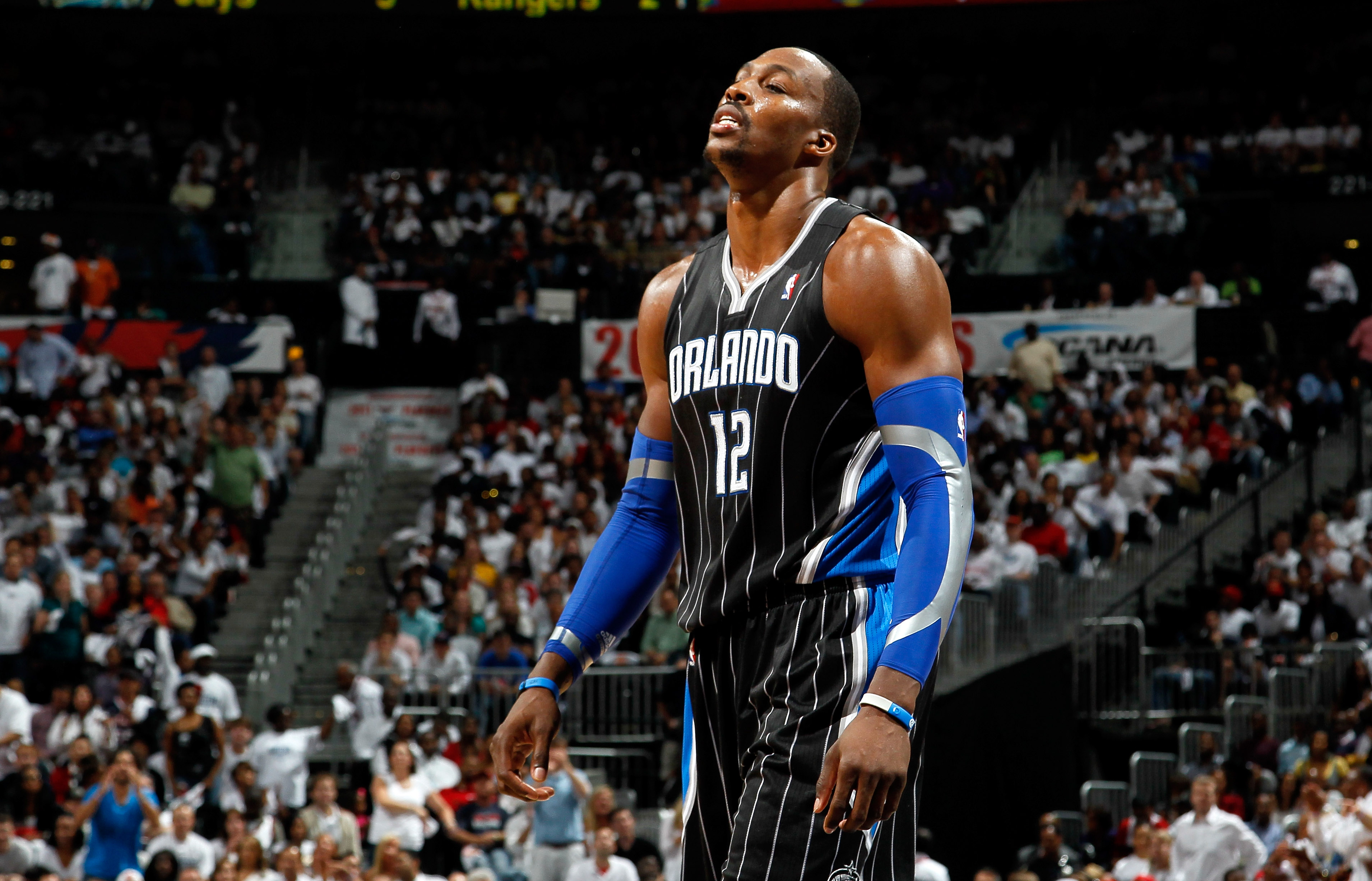 ATLANTA, GA - APRIL 28:  Dwight Howard #12 of the Orlando Magic walks to the bench after a turnover to the Atlanta Hawks during Game Six of the Eastern Conference Quarterfinals in the 2011 NBA Playoffs at Philips Arena on April 28, 2011 in Atlanta, Georgi