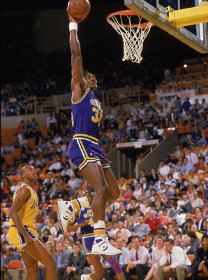 SALT LAKE CITY - 1988:  Karl Malone #32 of the Utah Jazz dunks the ball during an NBA game at The Salt Palace in Salt Lake City, Utah in 1988. (Photo by Stephen Dunn/Getty Images)