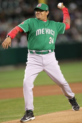 ANAHEIM, CA - MARCH 12:  Fernando Valenzuela #34 of Team Mexico throws out the first pitch before the Round 2 Pool 2 Game of the World Baseball Classic against Team Korea at Angel Stadium on March 12, 2006 in Anaheim, California.  (Photo by Stephen Dunn/G