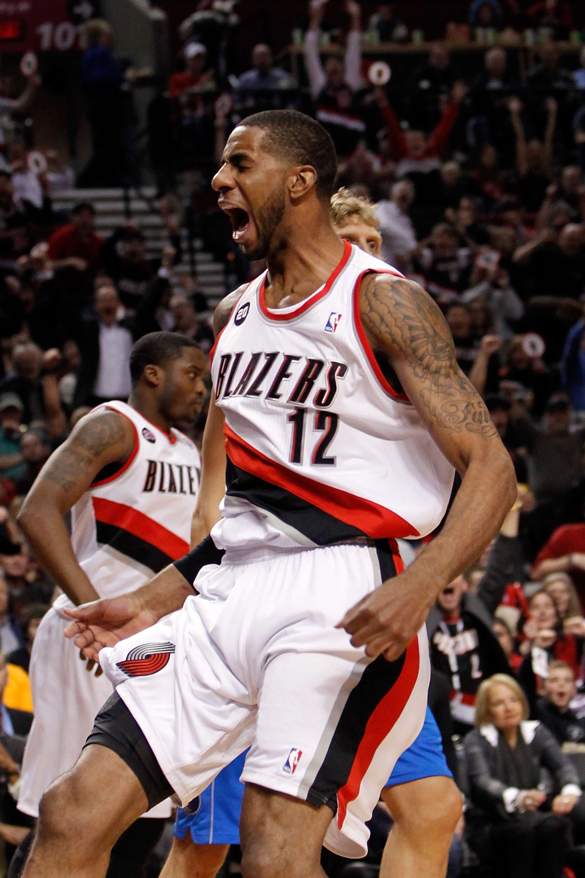 PORTLAND, OR - APRIL 21:  LaMarcus Aldridge #12 of the Portland Trail Blazers celebrates a dunk against the Dallas Mavericks in Game Three of the Western Conference Quarterfinals in the 2011 NBA Playoffs on April 21, 2011 at the Rose Garden in Portland, O
