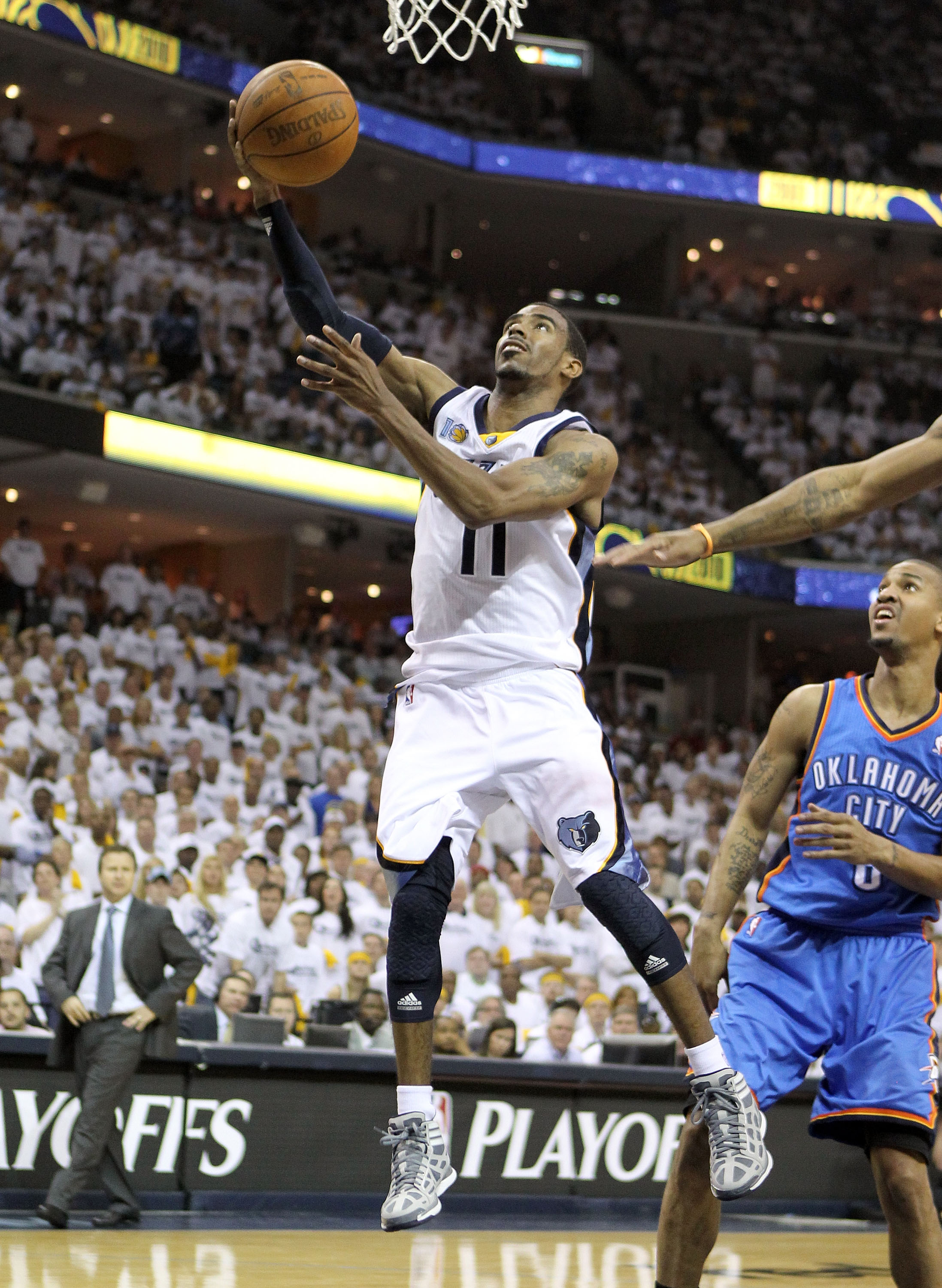 MEMPHIS, TN - MAY 07:  Mike Conley #11 of the  Memphis Grizzlies shoots the ball during the game against the Oklahoma City Thunder in Game Three of the Western Conference Semifinals in the 2011 NBA Playoffs at FedExForum on May 7, 2011 in Memphis, Tenness
