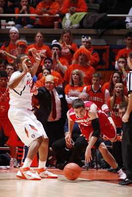 CHAMPAIGN, IL - JANUARY 22: Jereme Richmond #22 of the Illinois Fighting Illini reacts after being called for a foul while defending against Jon Diebler #33 of the Ohio State Buckeyes at Assembly Hall on January 22, 2011 in Champaign, Illinois. Ohio State