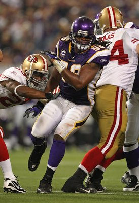 MINNEAPOLIS - SEPTEMBER 27: E.J.  Henderson #56 of the Minnesota Vikings rushes past a block attempt against the San Francisco 49ers at the Hubert H. Humphrey Metrodome on September 27, 2009 in Minneapolis, Minnesota. The Vikings defeated the 49ers 27-24.