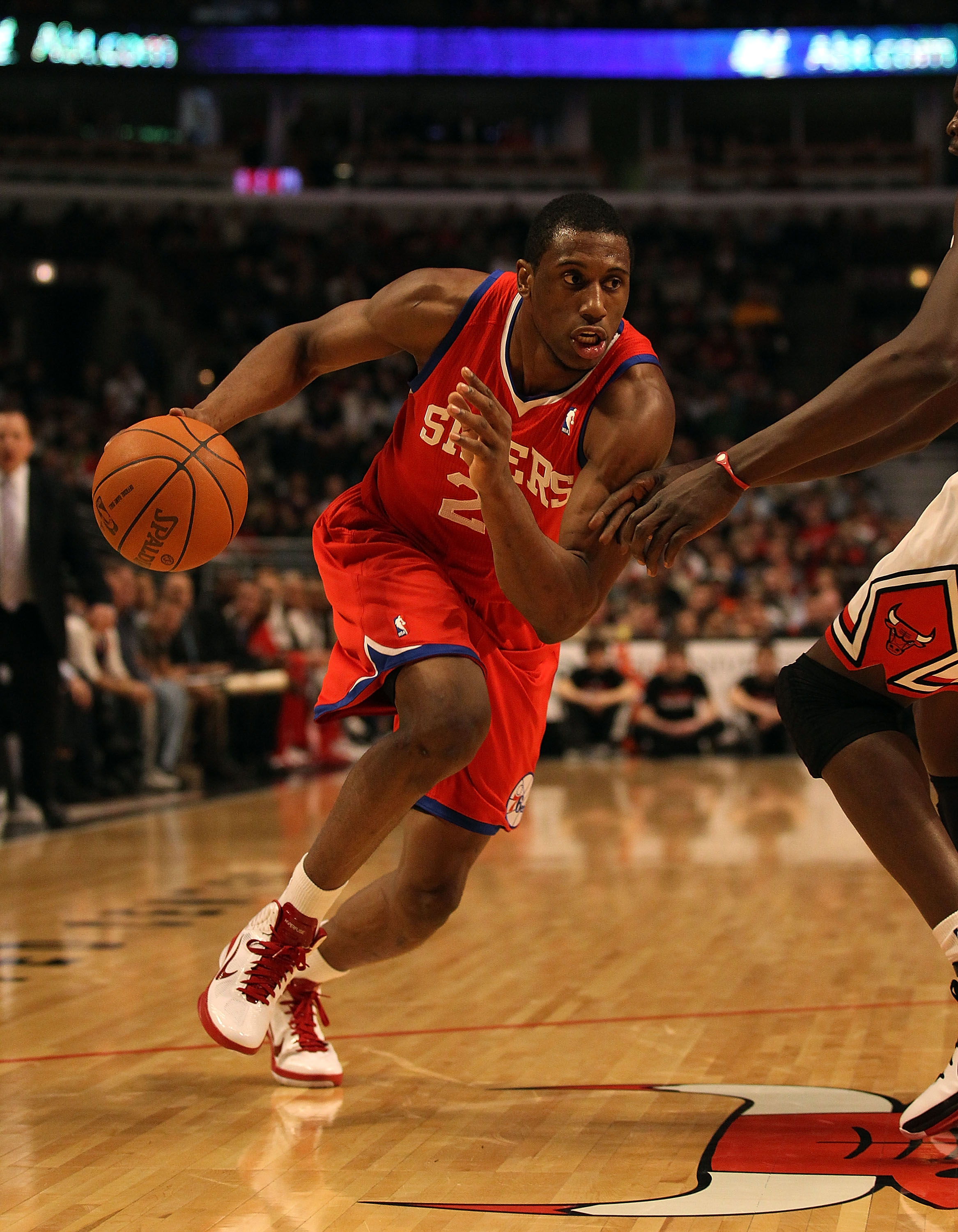 CHICAGO, IL - DECEMBER 21: Thaddeus Young #21 of the Philadelphia 76ers drives to the basket against the Chicago Bulls at the United Center on December 21, 2010 in Chicago, Illinois. The Bulls defeated the 76ers 121-76. NOTE TO USER: User expressly acknow