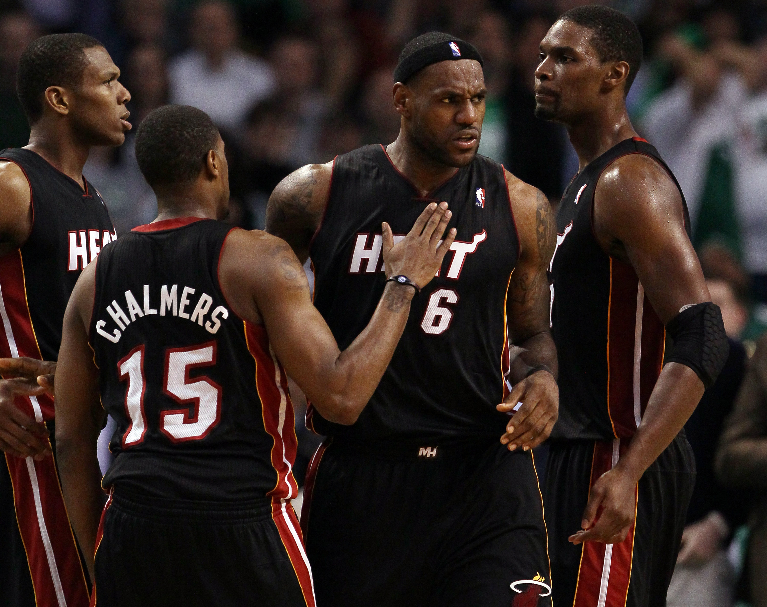BOSTON, MA - MAY 09: LeBron James #6 of the Miami Heat is congratulated by teammates Chris Bosh  #1 and Mario Chalmers #15 after James drew the foul in the second half against the Boston Celtics in Game Four of the Eastern Conference Semifinals in the 201