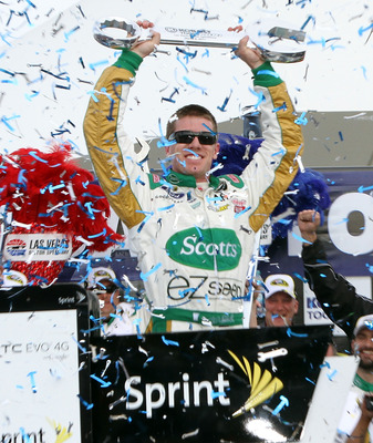 LAS VEGAS, NV - MARCH 06:  Carl Edwards, driver of the #99 Scotts/Kellogg's Ford, celebrates in Victory Lane after winning the NASCAR Sprint Cup Series Kobalt Tools 400 at Las Vegas Motor Speedway on March 6, 2011 in Las Vegas, Nevada.  (Photo by Jerry Ma