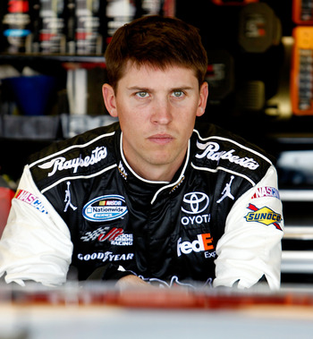 DARLINGTON, SC - MAY 06:  Denny Hamlin, driver of the #11 Sport Clips Toyota, stands in the garage during practice for the NASCAR Sprint Cup Series SHOWTIME Southern 500 at Darlington Raceway on May 6, 2011 in Darlington, South Carolina.  (Photo by Jeff Z
