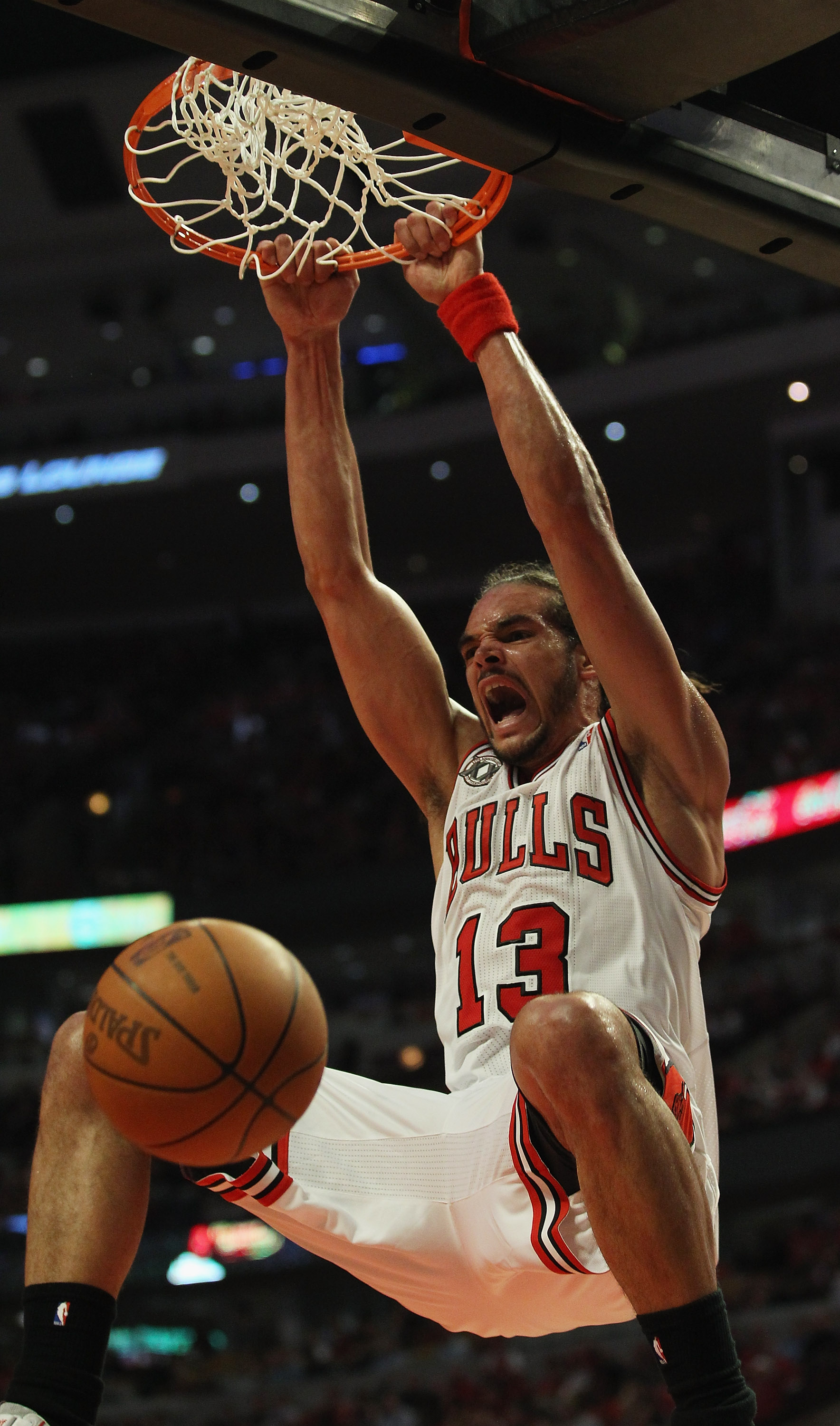 CHICAGO, IL - MAY 02: Joakim Noah #13 of the Chicago Bulls dunks the ball against the Atlanta Hawks in Game One of the Eastern Conference Semifinals in the 2011 NBA Playoffs at the United Center on May 2, 2011 in Chicago, Illinois. The Hawks defeated the