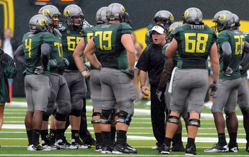 EUGENE, OR - SEPTEMBER 18: Head coach Chip Kelly of the Oregon Ducks has some words with his offensive unit during a time out in the second quarter of the game against the Portland State Vikings at Autzen Stadium on September 18, 2010 in Eugene, Oregon.