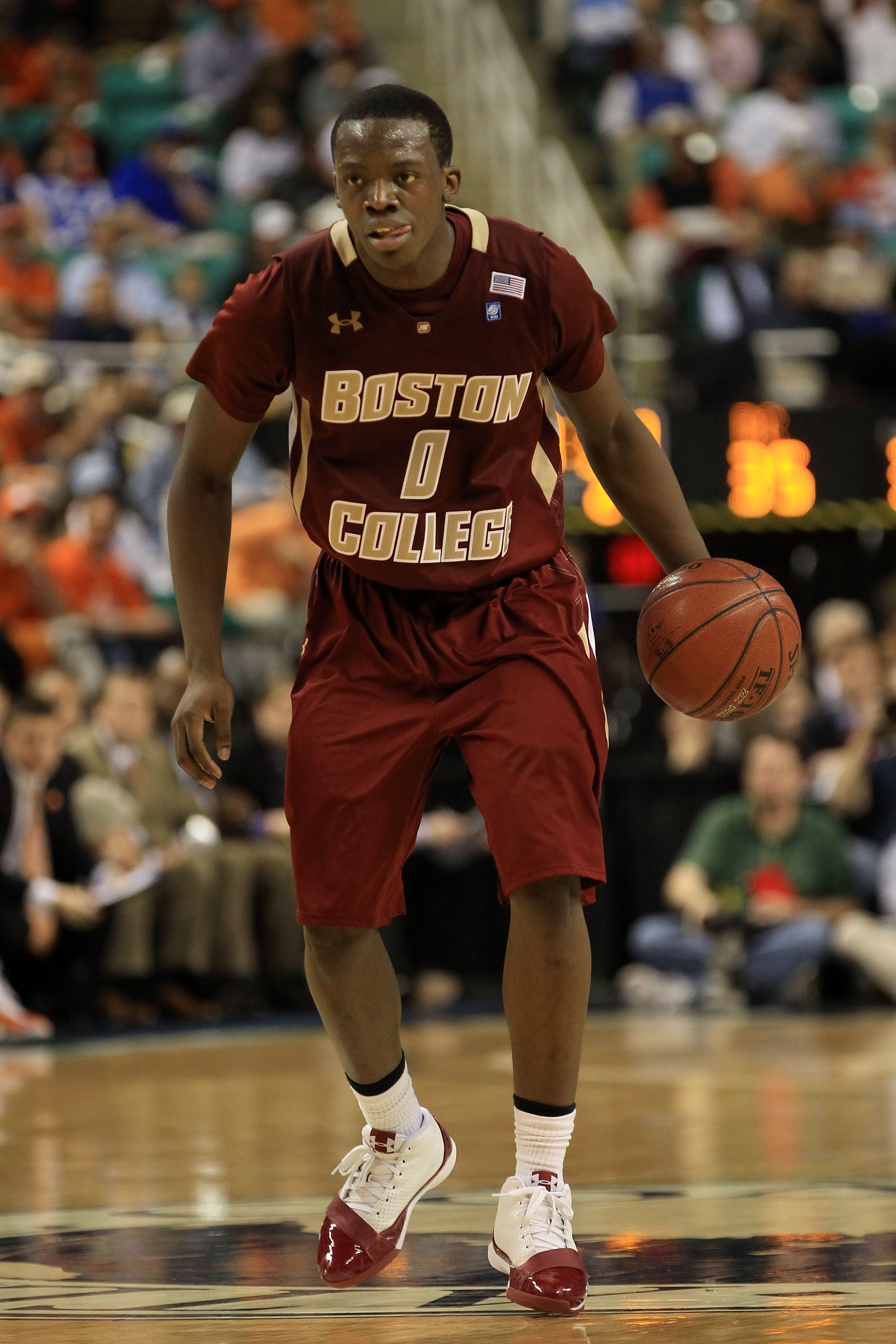 GREENSBORO, NC - MARCH 11:  Reggie Jackson #0 of the Boston College Eagles moves the ball against the Clemson Tigers during the second half in the quarterfinals of the 2011 ACC men's basketball tournament at the Greensboro Coliseum on March 11, 2011 in Gr