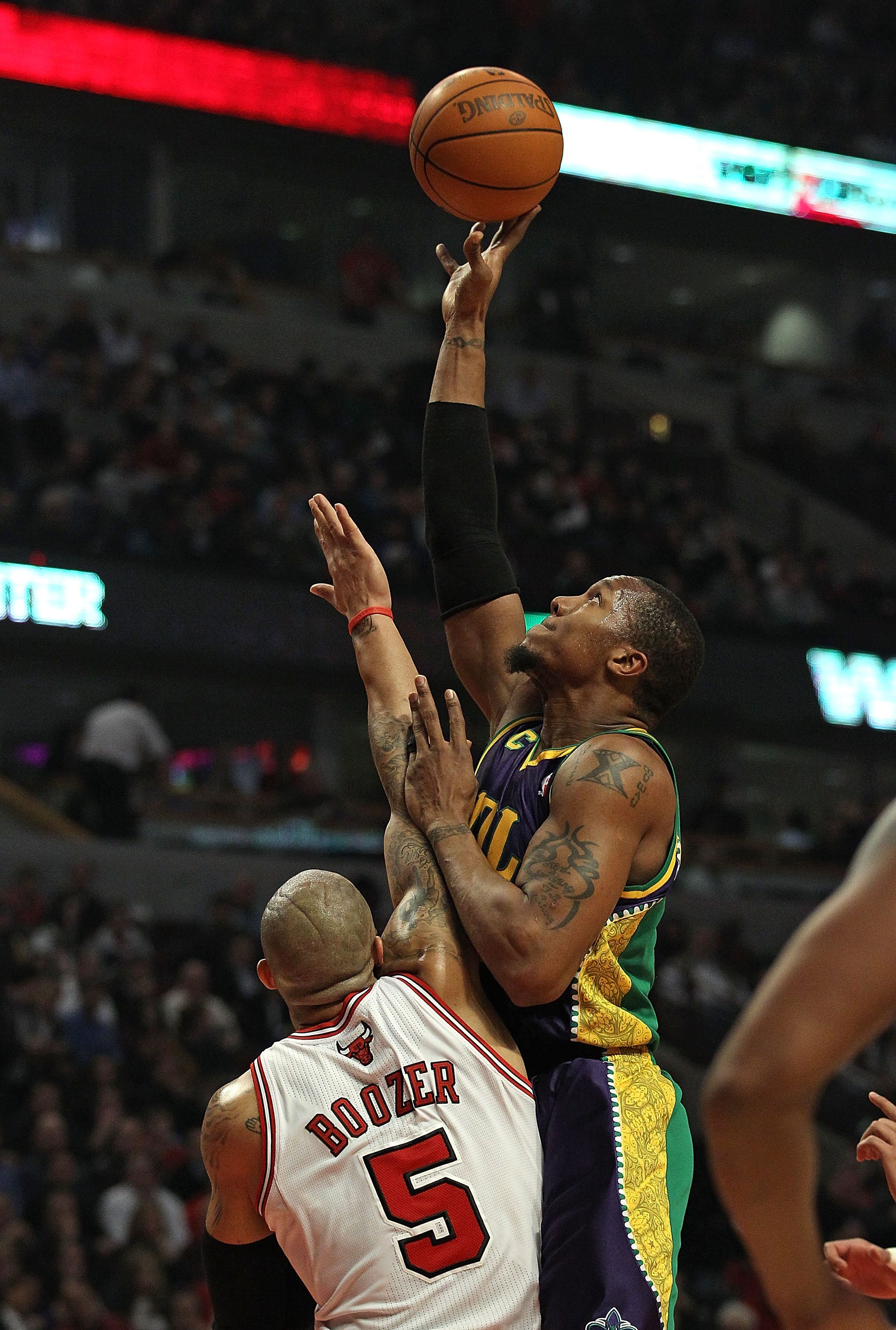 CHICAGO, IL - MARCH 07: David West #30 of the New Orleans Hornets puts up a shot over Carlos Boozer #5 of the Chicago Bulls at the United Center on March 7, 2011 in Chicago, Illinois. The Bulls defeated the Hornets 85-77. NOTE TO USER: User expressly ackn