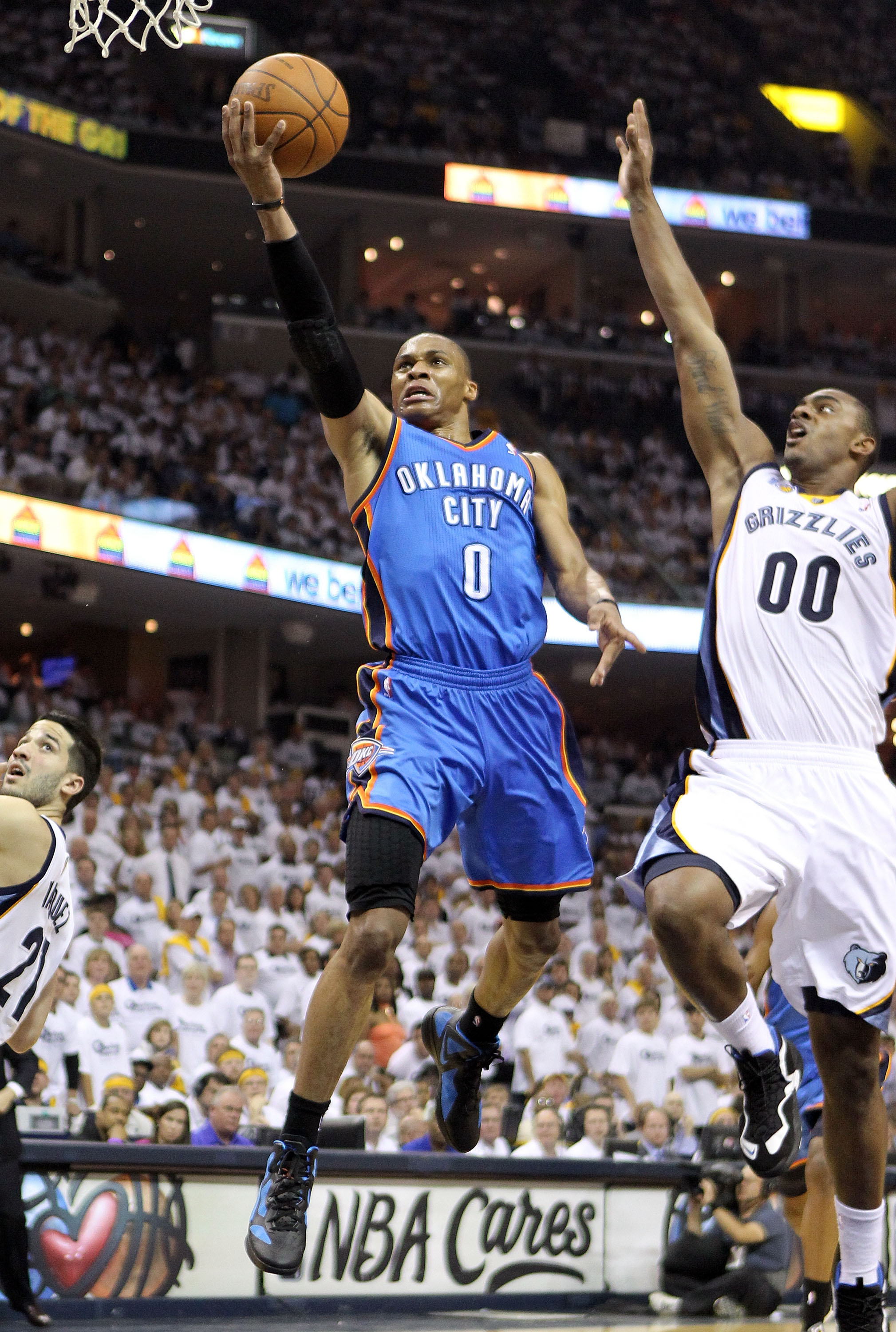 MEMPHIS, TN - MAY 09:  Russell Westbrook #0 of the Oklahoma City Thunder shoots the ball while defended by Darrell Arthur #00 of the Memphis Grizzlies in Game Four of the Western Conference Semifinals in the 2011 NBA Playoffs at FedExForum on May 9, 2011