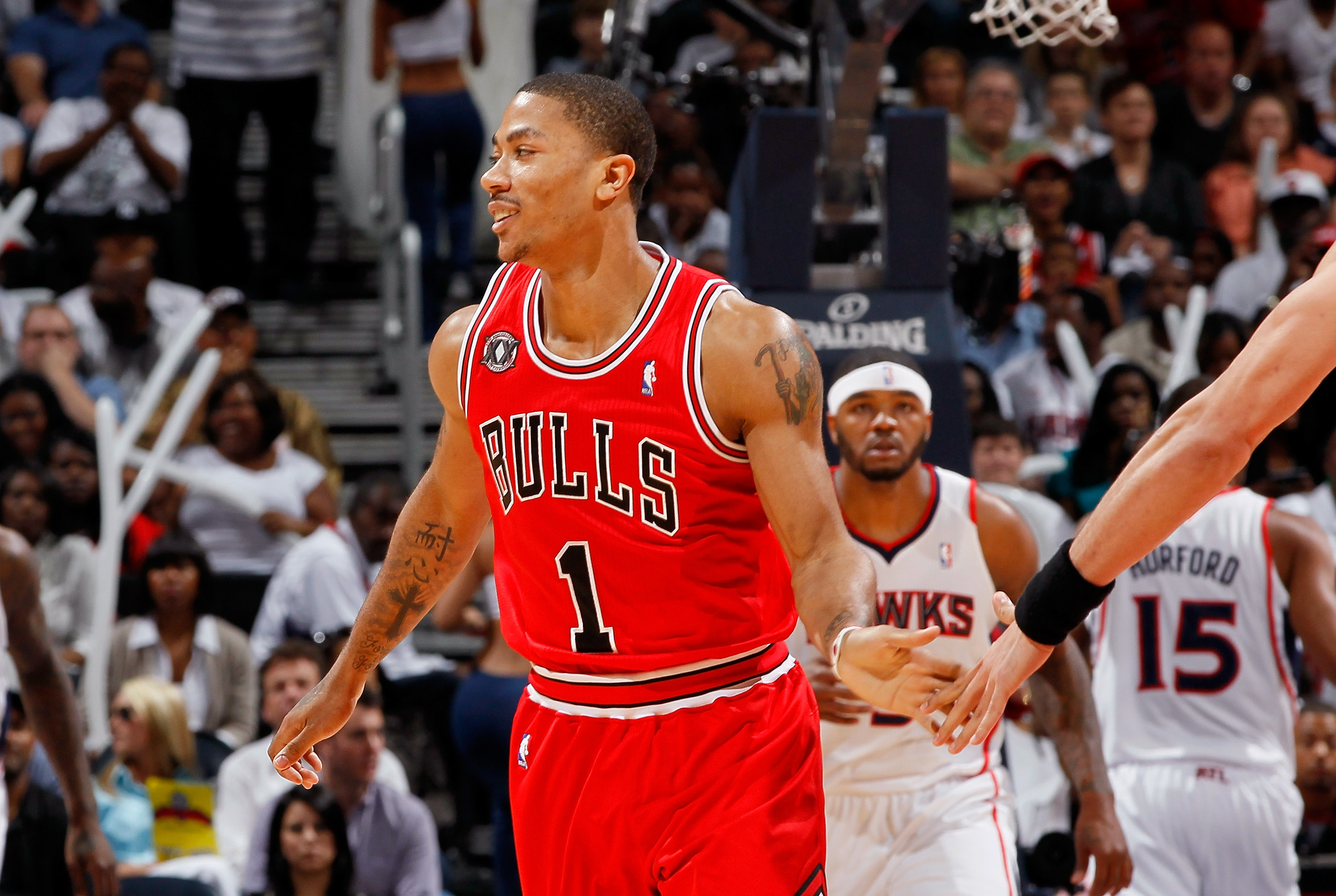 ATLANTA, GA - MAY 06:  Derrick Rose #1 of the Chicago Bulls reacts after hitting a three-point basket against the Atlanta Hawks in Game Three of the Eastern Conference Semifinals in the 2011 NBA Playoffs at Phillips Arena on May 6, 2011 in Atlanta, Georgi