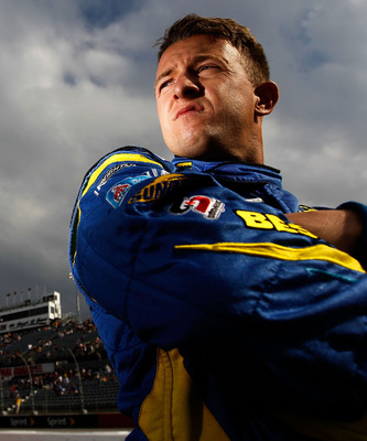 DARLINGTON, SC - MAY 06:  A.J. Allmendinger, driver of the #43 Best Buy Ford, stands on the grid during qualifying for the NASCAR Sprint Cup Series SHOWTIME Southern 500 at Darlington Raceway on May 6, 2011 in Darlington, South Carolina.  (Photo by Tom Pe