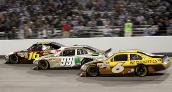 RICHMOND, VA - APRIL 30: David Ragan, driver of the #6 UPS Ford races with Carl Edwards, driver of the #99 Scotts eZ Seed Ford and Greg Biffle, driver of the #16 3M Ford during the NASCAR Sprint Cup Series Crown Royal Presents The Matthew & Daniel Hansen