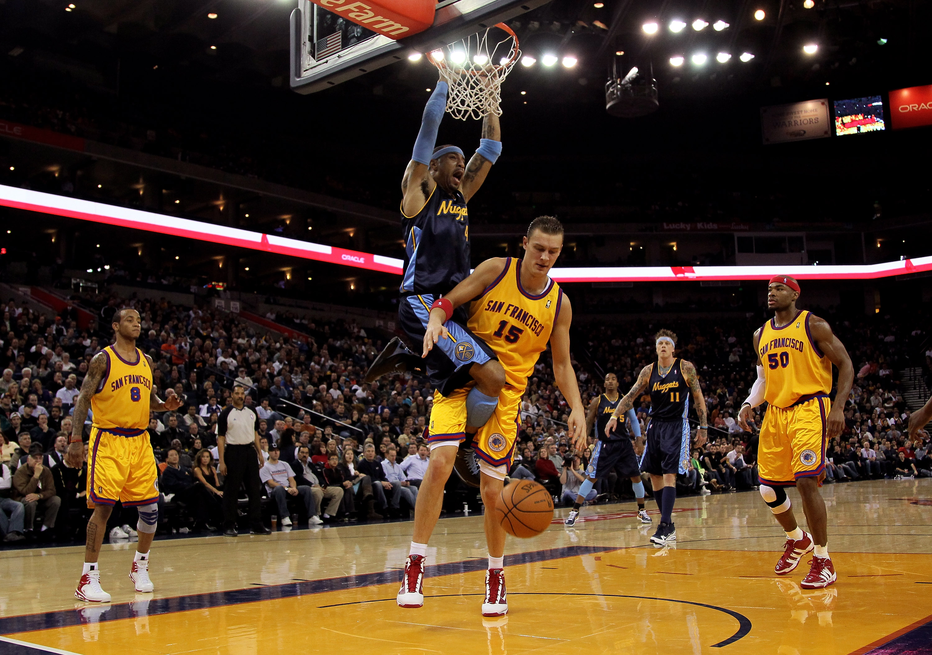 OAKLAND, CA - JANUARY 20:  Kenyon Martin #4 of the Denver Nuggets dunks on Andris Biedrins #15 of the Golden State Warriors at Oracle Arena on January 20, 2010 in Oakland, California.  NOTE TO USER: User expressly acknowledges and agrees that, by download