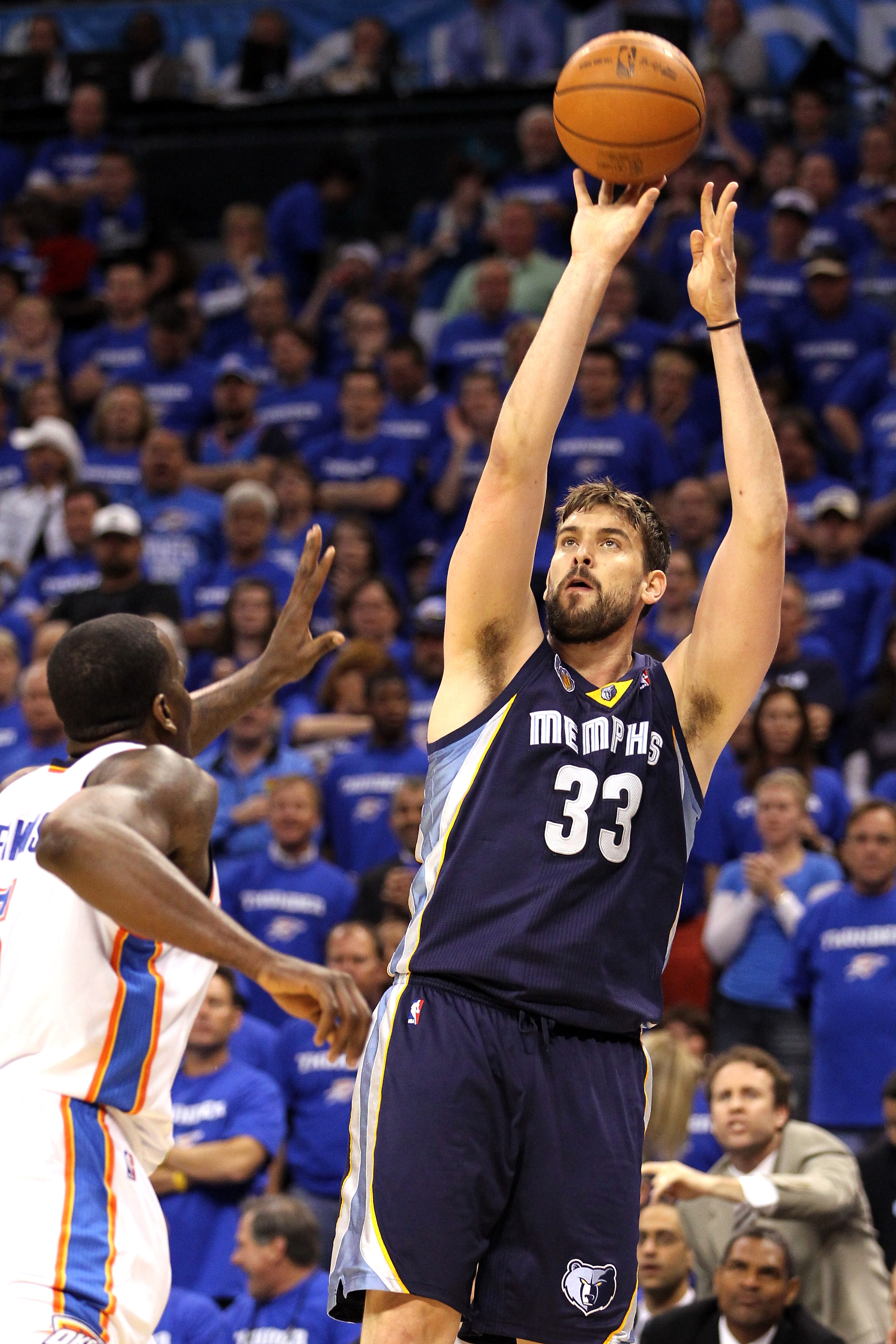 OKLAHOMA CITY, OK - MAY 03:  Marc Gasol #33 of the Memphis Grizzlies shoots a jumper over Kendrick Perkins #5 of the Oklahoma City Thunder in the first quarter in Game Two of the Western Conference Semifinals in the 2011 NBA Playoffs on May 3, 2011 at Okl