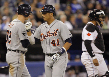 TORONTO, CANADA - MAY 9: Victor Martinez #41 and Don Kelly #32 of the Detroit Tigers celebrate a home run in front of Jose Molina #8 of the Toronto Blue Jays during MLB action at the Rogers Centre May 9, 2011 in Toronto, Ontario, Canada. (Photo by Abelima