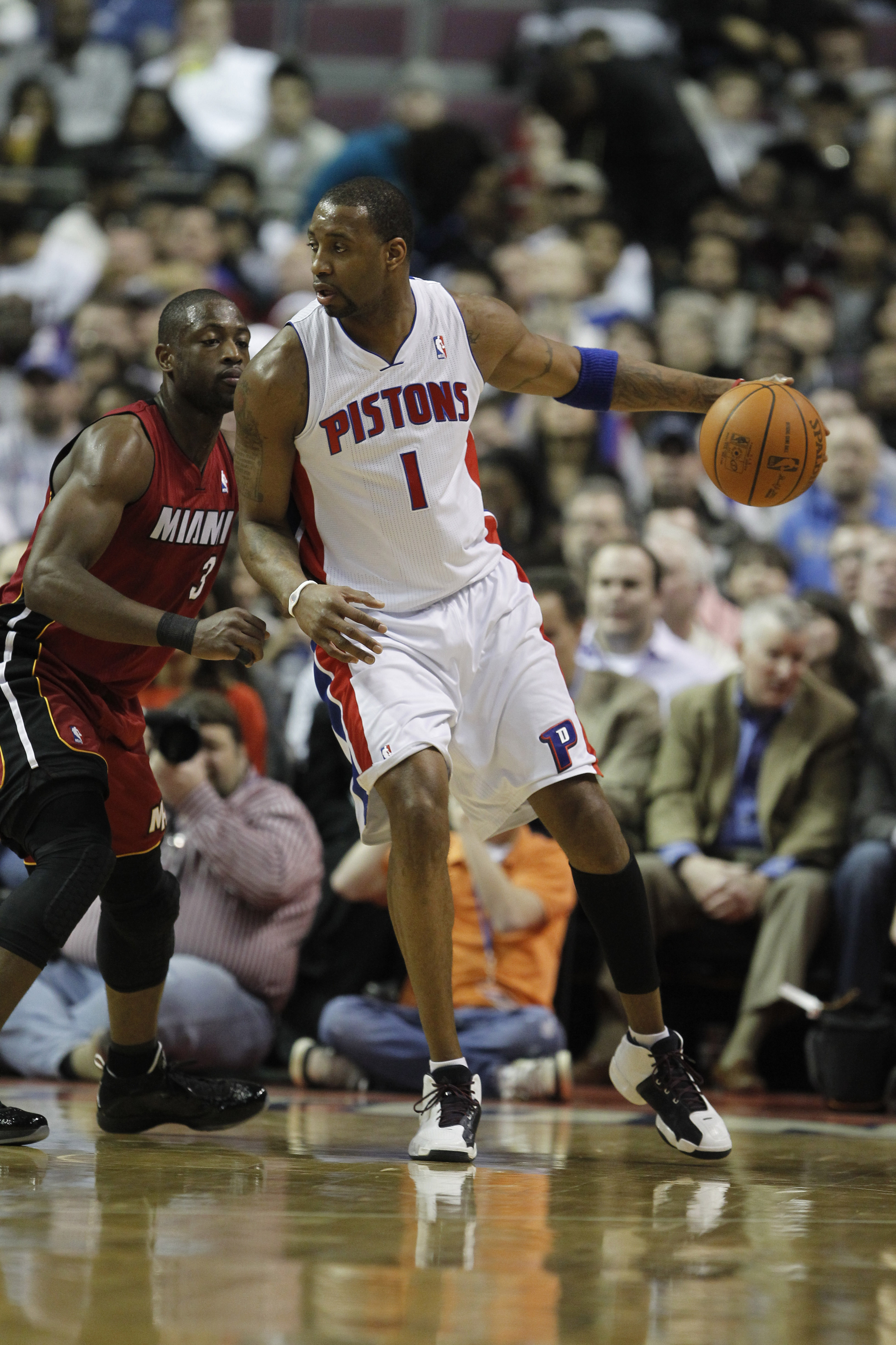 AUBURN HILLS, MI - FEBRUARY 11:  Tracy McGrady #1 of the Detroit Pistons controls the ball while playing the Miami Heat at The Palace of Auburn Hills on February 11, 2011 in Auburn Hills, Michigan.  (Photo by Gregory Shamus/Getty Images)
