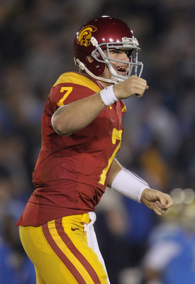 PASADENA, CA - DECEMBER 04:  Quarterback Matt Barkley #7 of the USC Trojans celebrates following a touchdown by running back Allen Bradford (not pictured) late in the second half against the UCLA Bruins at the Rose Bowl on December 4, 2010 in Pasadena, Ca