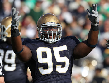SOUTH BEND, IN - SEPTEMBER 04: Ian Williams #95 of the Notre Dame Fighting Irish encourages the crowd during a game against the Purdue Boilermakers at Notre Dame Stadium on September 4, 2010 in South Bend, Indiana. Notre Dame defeated Purdue 23-12. (Photo