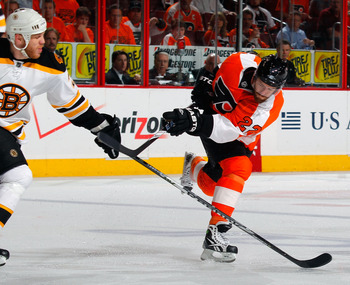 PHILADELPHIA, PA - MAY 02:  Ville Leino #22 of the Philadelphia Flyers shoots in Game Two of the Eastern Conference Semifinals against the Boston Bruins during the 2011 NHL Stanley Cup Playoffs at Wells Fargo Center on May 2, 2011 in Philadelphia, Pennsyl