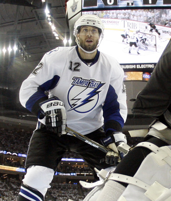 PITTSBURGH, PA - APRIL 27:  Simon Gagne #12 of the Tampa Bay Lightning skates against the Pittsburgh Penguins in Game Seven of the Eastern Conference Quarterfinals during the 2011 NHL Stanley Cup Playoffs at Consol Energy Center on April 27, 2011 in Pitts