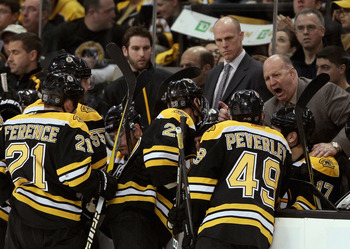 BOSTON, MA - APRIL 23:  Head coach Claude Julien of the Boston Bruins talks with his players during a time out against the Montreal Canadiens in Game Five of the Eastern Conference Quarterfinals during the 2011 NHL Stanley Cup Playoffs at TD Garden on Apr