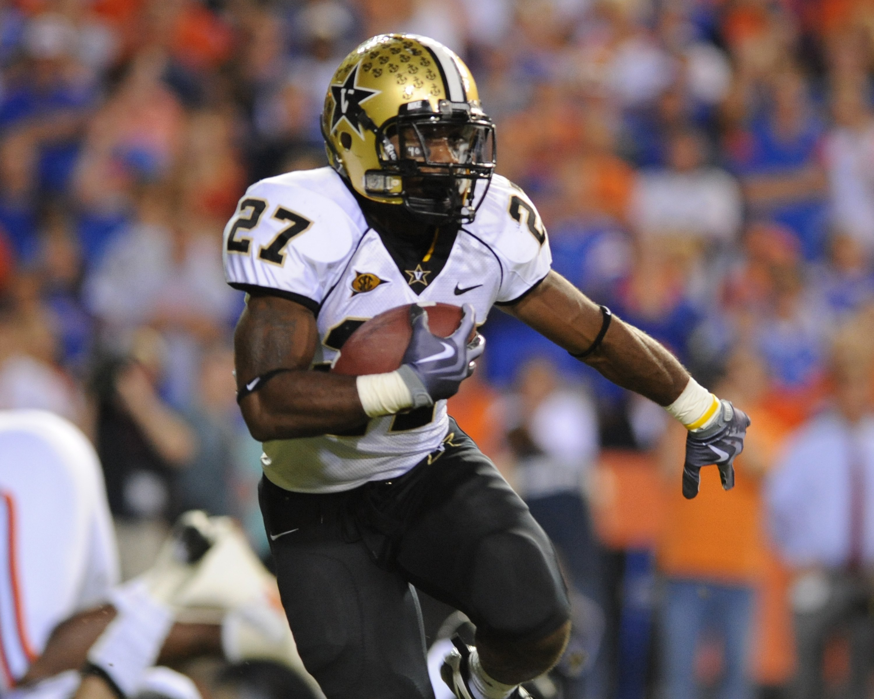 GAINESVILLE, FL - NOVEMBER 7: Running back Warren Norman #27 of the Vanderbilt Commodores rushes upfield against the Florida Gators on November 7, 2009 at Ben Hill Griffin Stadium in Gainesville, Florida.  (Photo by Al Messerschmidt/Getty Images)
