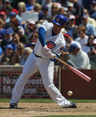 CHICAGO, IL - MAY 08: Carlos Pena #22 of the Chicago Cubs takes a swing against the Cincinnati Reds at Wrigley Field on May 8, 2011 in Chicago, Illinois. The Reds defeated the Cubs 2-0. (Photo by Jonathan Daniel/Getty Images)