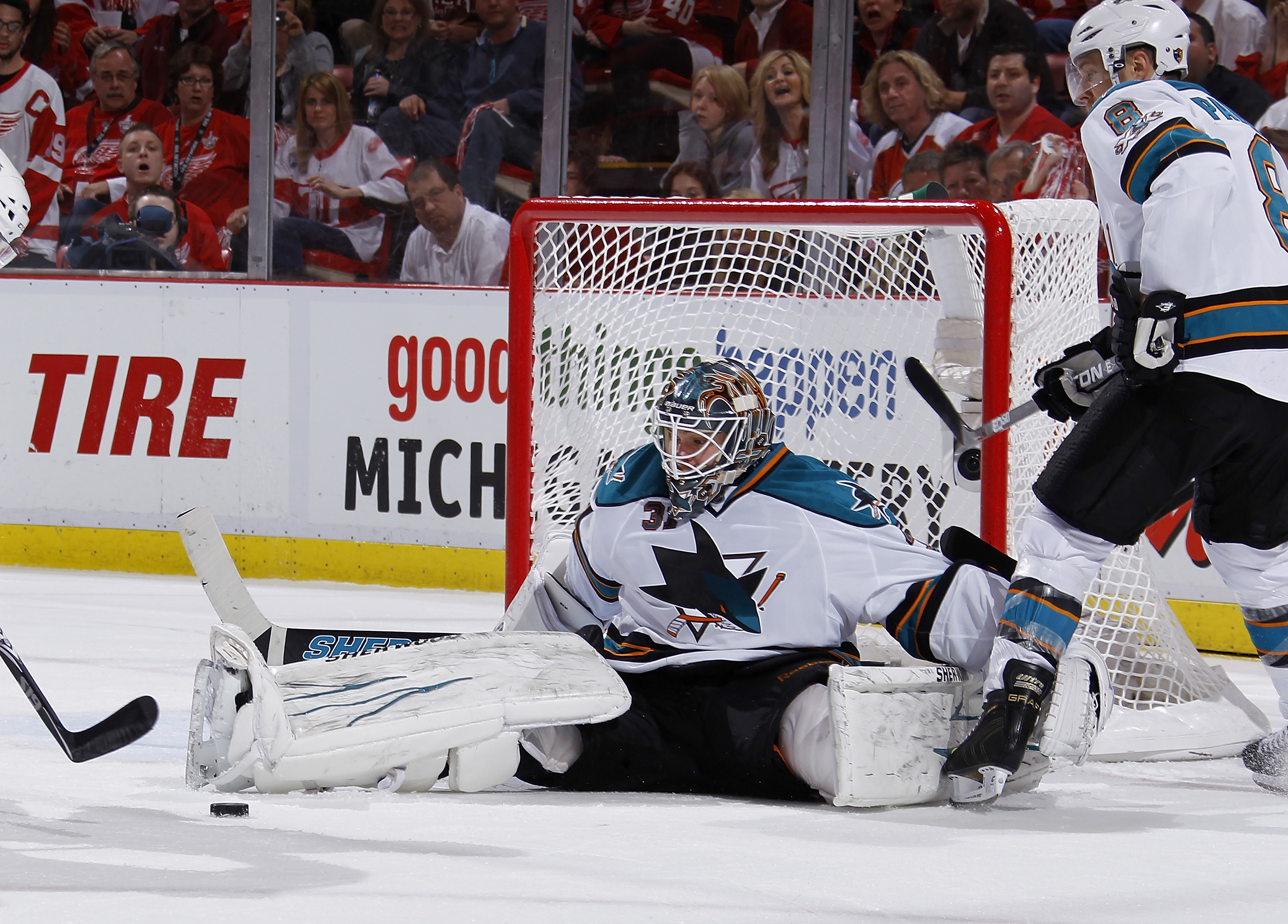 DETROIT - MAY 10: Antti Niemi #31 of the San Jose Sharks watches the rebound in the second period after saving a goal shot by the Detroit Red Wings in Game Six of the Western Conference Semifinals during the 2011 NHL Stanley Cup Playoffs on May 10, 2011 a