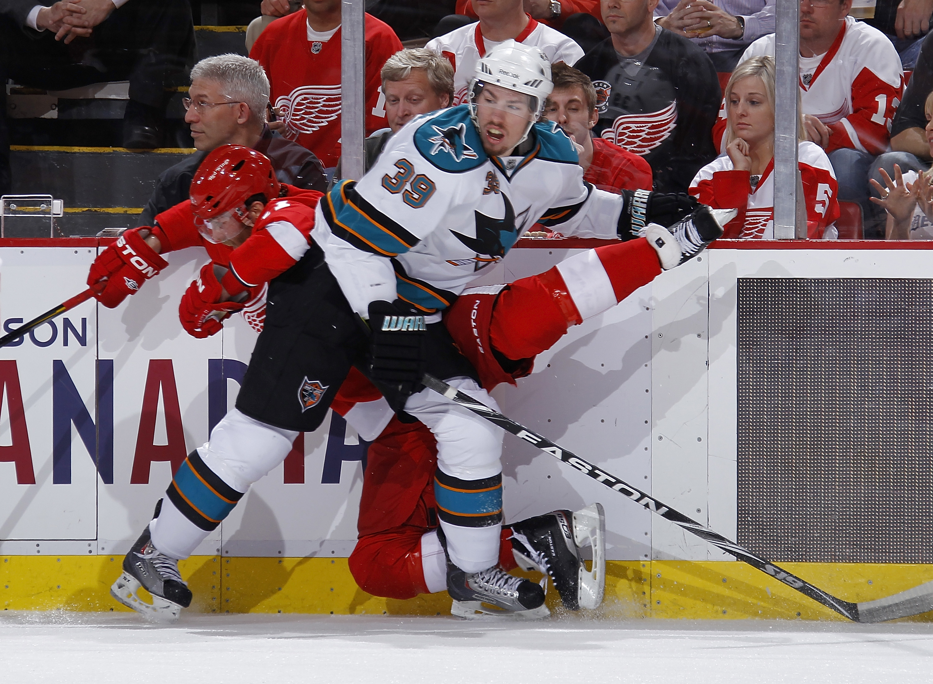 DETROIT - MAY 10: Logan Couture #39 of the San Jose Sharks checks Daniel Cleary #11 of the Detroit Red Wings into the boards during the first period in Game Six of the Western Conference Semifinals during the 2011 NHL Stanley Cup Playoffs on May 10, 2011
