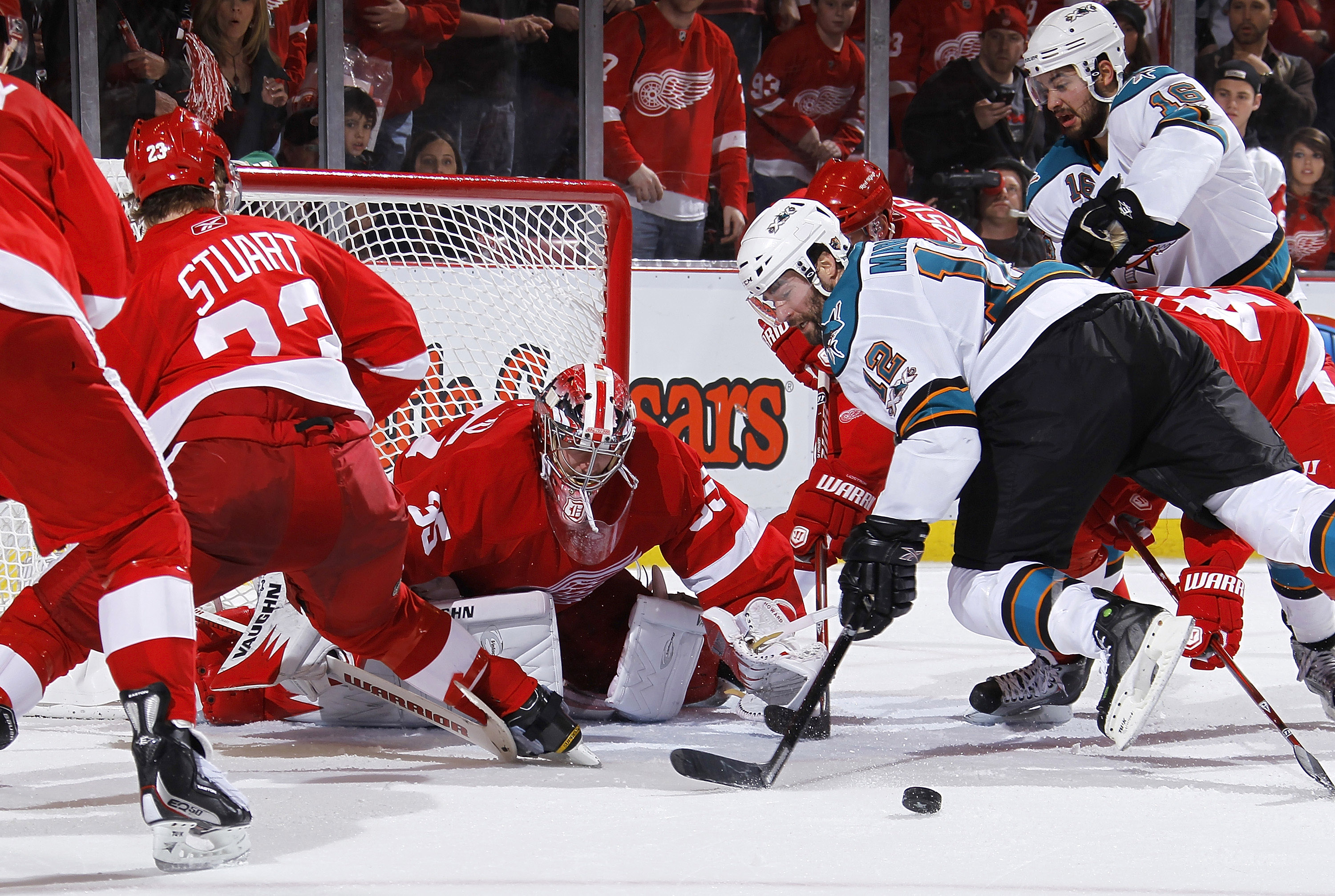 DETROIT - MAY 6: Patrick Marleau #12 of the San Jose Sharks can't get a shot off in front of Jimmy Howard #35 of the Detroit Red Wings during the third period in Game Four of the Western Conference Semifinals during the 2011 NHL Stanley Cup Playoffs on Ma