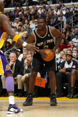 LOS ANGELES - MARCH 30:  Michael Finley #4 of the San Antonio Spurs holds the ball against the Los Angeles Lakers on March 30, 2006 at Staples Center in Los Angeles, California.  The Spurs won 96-85. (Photo by Stephen Dunn/Getty Images)