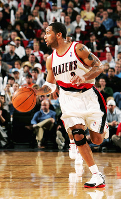 PORTLAND, OR - NOVEMBER 19: Damon Stoudamire #3 dribbles the ball of the Portland Trail Blazers during the Milwaukee Bucks versus Portland Trail Blazers game on November 19, 2004 at the Rose Garden in Portland, Oregon. NOTE TO USER: User expressly acknowl