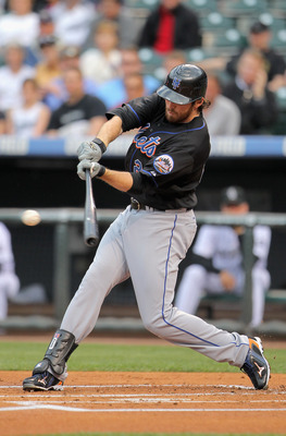 DENVER, CO - MAY 10:  Ike Davis #29 of the New York Mets hits a two RBI single off of starting pitcher Jason Hammel #46 of the Colorado Rockies in the first inning at Coors Field on May 10, 2011 in Denver, Colorado.  (Photo by Doug Pensinger/Getty Images)