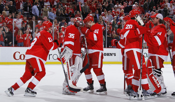 SAN JOSE, CA - MAY 08:  Drew Miller #20 (from left), Jonathan Ericsson #52 and Niklas Kronwall #55  of the Detroit Red Wings celebrate on the bench after Tomas Holmstrom #96 of the Detroit Red Wings scored the winning goal against the San Jose Sharks  in