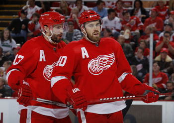 DETROIT - MAY 10: Pavel Datsyuk #13 and Henrik Zetterberg #40 of the Detroit Red Wings talk during the second period while playing the San Jose Sharks in Game Six of the Western Conference Semifinals during the 2011 NHL Stanley Cup Playoffs on May 10, 201