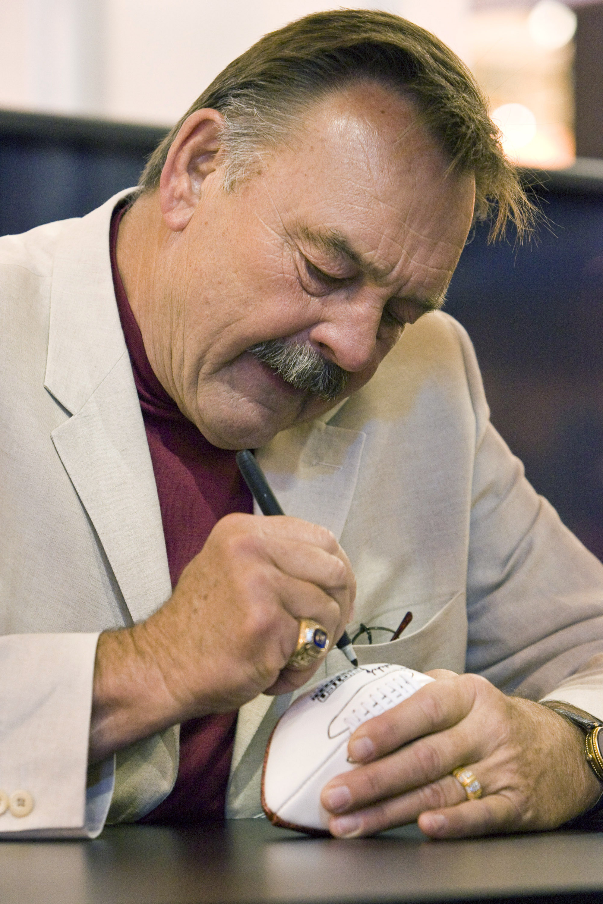 NEW ORLEANS - MAY 19: 2008 Pro Football Hall of Fame member and legendary Chicago Bears linebacker Dick Butkus takes time to sign footballs for fans in the Fox Cable Networks' booth at the The Cable Show in the Ernest N. Morial Convention Center on May 19