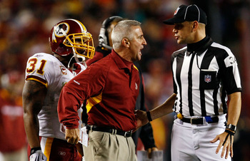 LANDOVER, MD - OCTOBER 26:  Special teams coach Danny Smith of the Washington Redskins argues with a referee during the game against the Philadelphia Eagles at FedEx Field October 26, 2009 in Landover, Maryland. The Eagles won the game 27-17.  (Photo by W