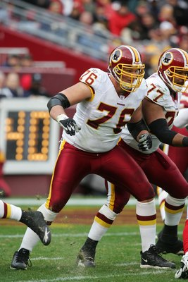 LANDOVER, MD - DECEMBER 3:  Offensive tackle Jon Jansen #76 of the Washington Redskins blocks against the Atlanta Falcons on December 3, 2006 at FedExField in Landover, Maryland. The Falcons defeated the Redskins 24-14. (Photo by Jim McIsaac/Getty Images)