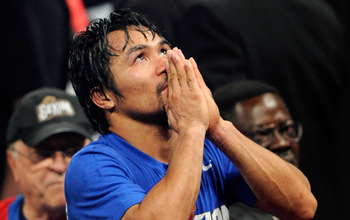 LAS VEGAS, NV - MAY 07:  Boxer Manny Pacquiao reacts at the end of his WBO welterweight title fight against Shane Mosley at the MGM Grand Garden Arena May 7, 2011 in Las Vegas, Nevada. Pacquiao retained his title by unanimous decision.  (Photo by Ethan Mi