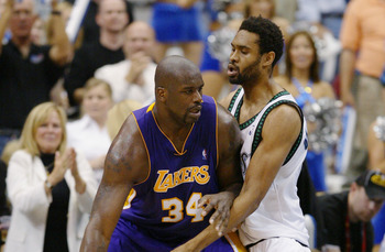 MINNEAPOLIS - MAY 29:  Shaquille O'Neal #34 of the Los Angeles Lakers dribbles the ball against Michael Olowokandi #34 of the Minnesota Timberwolves in Game five of the Western Conference Finals during the 2004 NBA Playoffs on May 29, 2004 atTarget Center