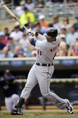 MINNEAPOLIS, MN - MAY 11: Victor Martinez #41 of the Detroit Tigers hits an RBI single against the Minnesota Twins during in the first inning of their game on May 11, 2011 at Target Field in Minneapolis, Minnesota. (Photo by Hannah Foslien/Getty Images)