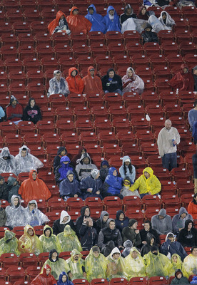 FRISCO, TX - MAY 1: Soccer fans brave a cold rain during a soccer match between FC Dallas and the Los Angeles Galaxy in the second half at Pizza Hut Park on May 1, 2011 in Frisco, Texas. The game was stopped midway through the second half due to severe we
