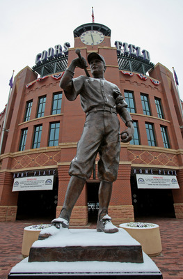 DENVER - OCTOBER 10:  The statue of 'The Player' is dusted with snow outside the stadium as Game 3 of the National League Division series between the Philadelphia Phillies and the Colorado Rockies at Coors Field has been postponed due to inclement weather