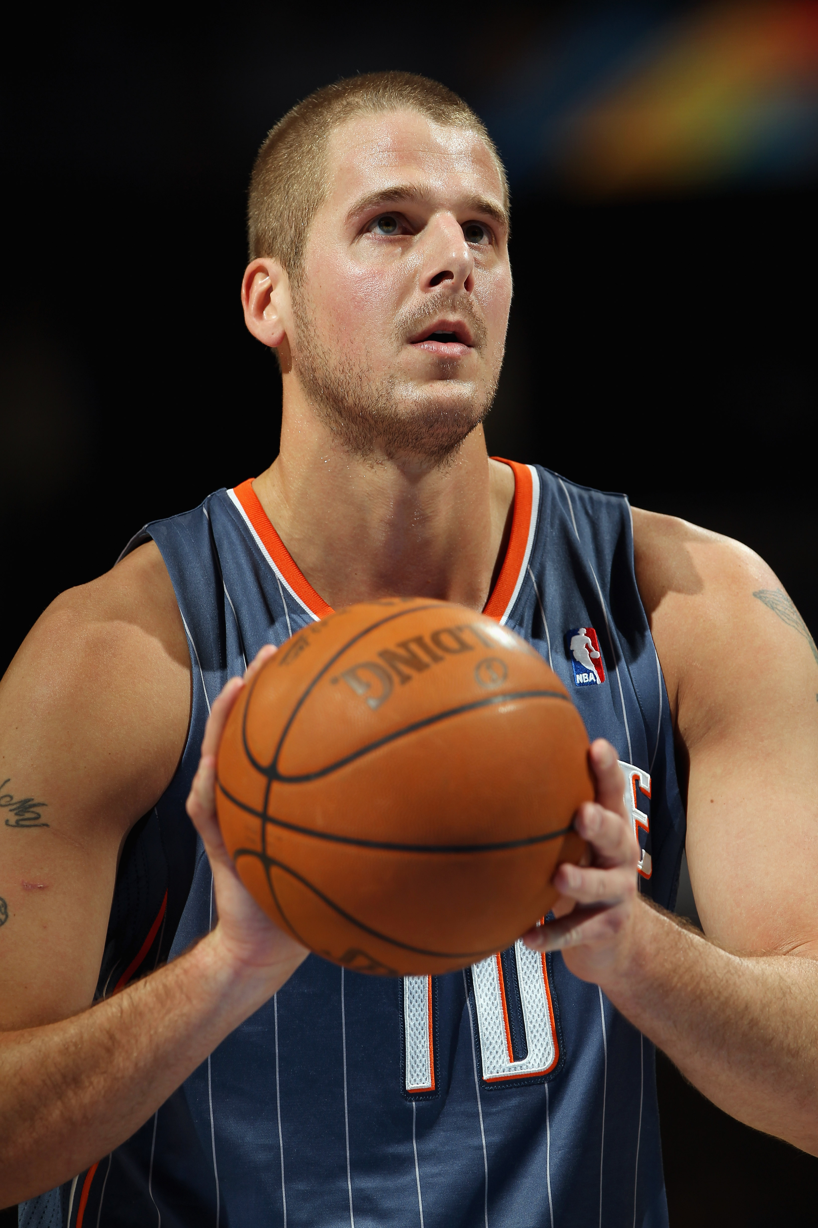 DENVER, CO - MARCH 02:  Joel Pryzbilla #10 of the Charlotte Bobcats takes a free throw against the Denver Nuggets at the Pepsi Center on March 2, 2011 in Denver, Colorado. The Nuggets defeated the Bobcats 120-80.NOTE TO USER: User expressly acknowledges a