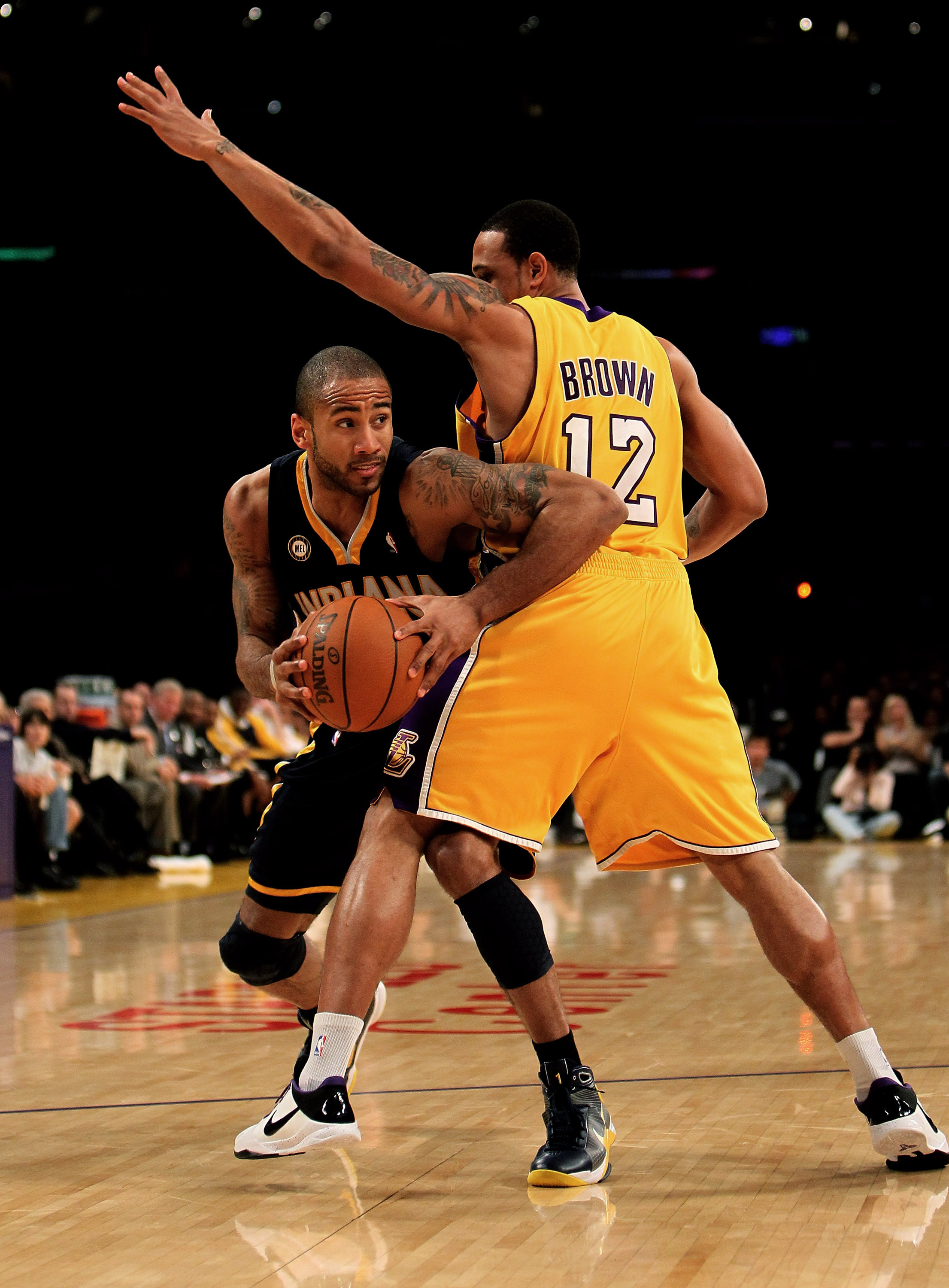 LOS ANGELES, CA - MARCH 02:  Dahntay Jones #1 of the Indiana Pacers drives against Shannon Brown #12 of the Los Angeles Lakers on March 2, 2010 at Staples Center in Los Angeles, California. The Lakers won 122-99.  NOTE TO USER: User expressly acknowledges