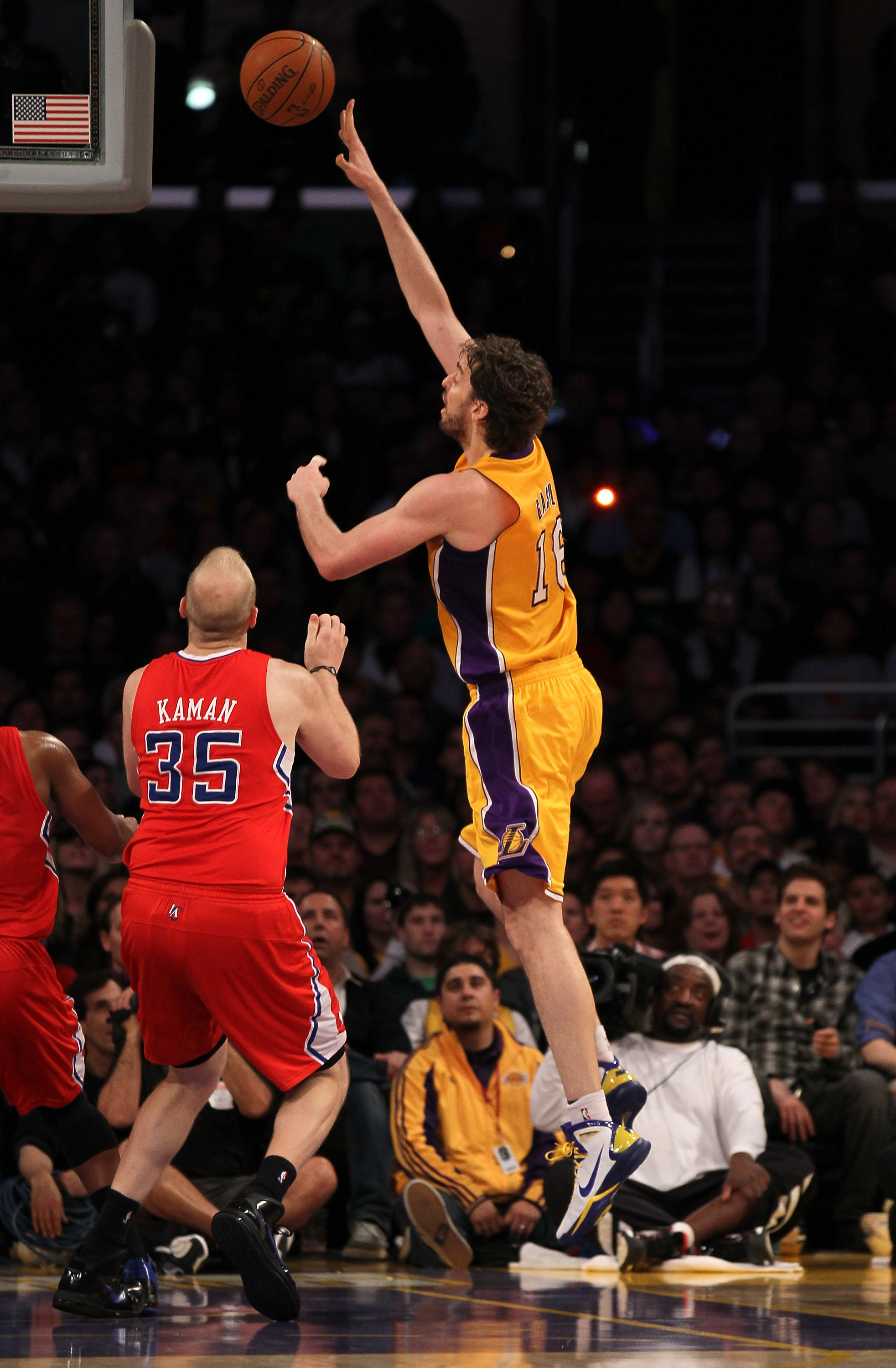LOS ANGELES, CA - FEBRUARY 25:  Pau Gasol #16 of the Los Angeles Lakers shoots over Chris Kaman #35 of the Los Angeles Clippers at Staples Center on February 25, 2011 in Los Angeles, California. The Lakers won 108-95.  NOTE TO USER: User expressly acknowl