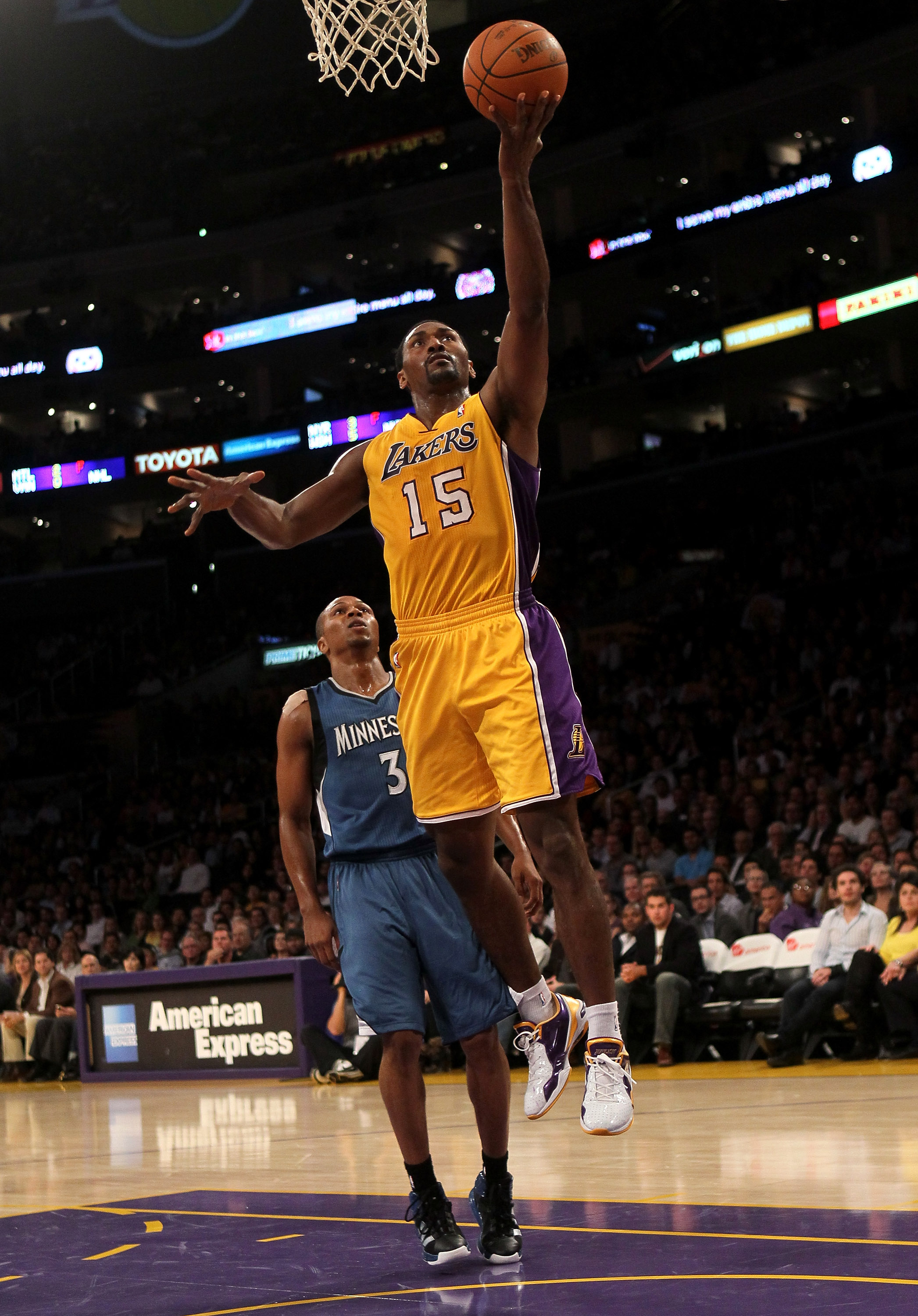 LOS ANGELES, CA - NOVEMBER 09:  Ron Artest #15 of the Los Angeles Lakers shoots over Sebastian Telfair #3 of the Minnesota Timberwolves at Staples Center on November 5, 2010 in Los Angeles, California.  The Lakers won 99-94.  NOTE TO USER: User expressly